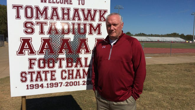 Riverdale principal Tom Nolan stands in front of a sign at Tomahawk Stadium. The field will be named in his honor on Friday during the Battle of the 'Boro.