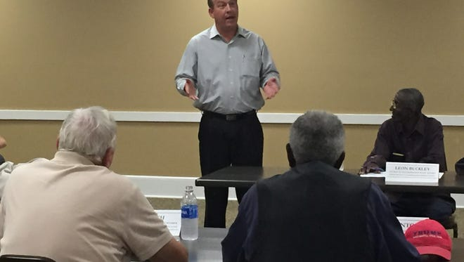 David Hogan, president of the Forrest County Board of Supervisors, answers questions Thursday during a Hattiesburg Council of Neighborhoods meeting.