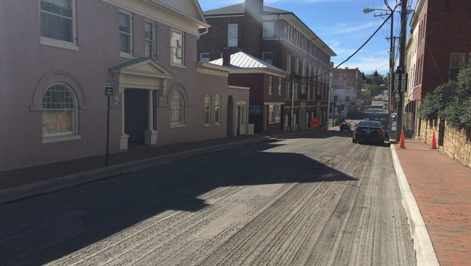Frederick Street awaits completion of a repaving project that's left the road surface rough in the interim, on Oct. 12, 2016, in Staunton, Va.
