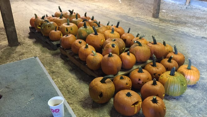 Finished jack o-lanterns pile up at the Champlain Valley Expo