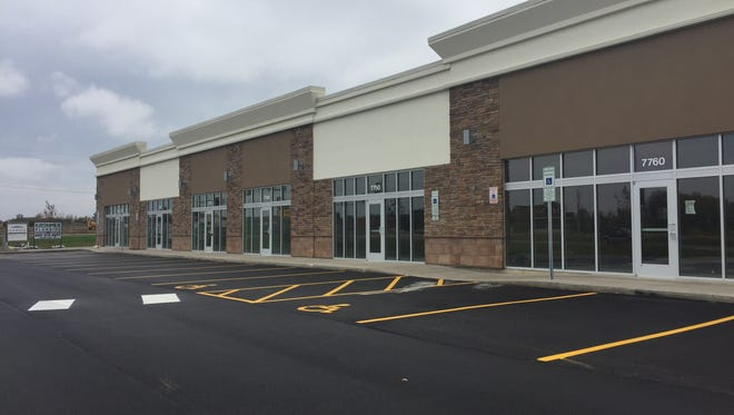 This strip mall on 85th Street near Walmart will open its first tenants in the coming months.