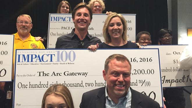 Grant recipients celebrate their awards at IMPACT 100's annual meeting Sunday at the Hilton Pensacola Beach Gulf Front. Ten organizations received grants of $108,200 from the group.