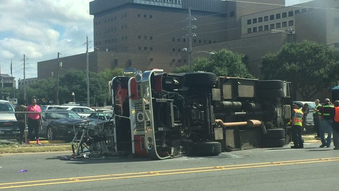 A firetruck is on its side near University Hospital.