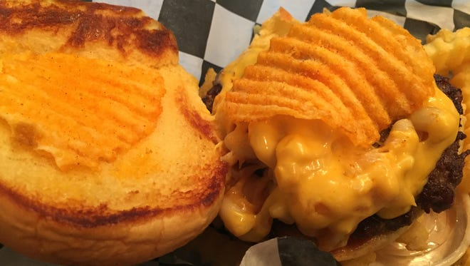 The Greg Brady - in honor of the cheesy TV character - is topped with macaroni and cheese, more melted cheese and barbecue chips.