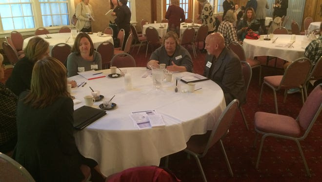 Participants at a meeting about the Wisconsin ALICE study stayed afterward to keep brainstorming ideas to help families near the poverty level.