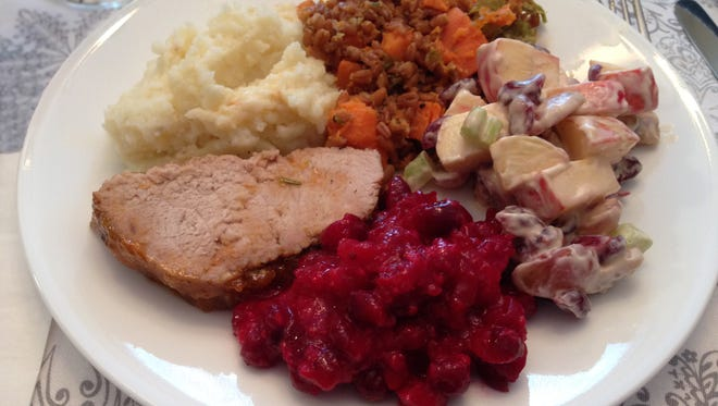 Thanksgiving Day dinner with turkey and four side dishes—mashed potatoes, sweet potatoes with farro, Waldorf salad and cranberries. Turkey is the main course. Its savory smells can make nostrils quiver, but it's the delicious side dishes with their showy color and texture that dress a plate.