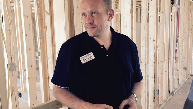 Cape Coral buyer's agent Ed Zoller inspects a D.R. Horton Express Home under construction in 2016 in the city's southwest corner. Such homes appeal to budget-conscious home buyers.