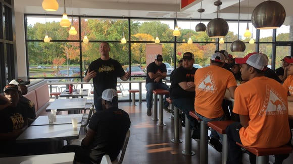 David Sloan, a CEO of Naf Naf Grill, rallies his new staff prior to opening the doors on the new fast casual eatery in Mount Laurel.