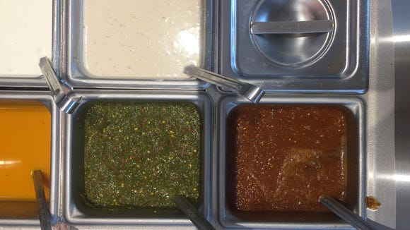 Sauces at Naf  Naf Grill are drawn from recipes all around the Middle East, from Lebanon to Yemen to Morocco.