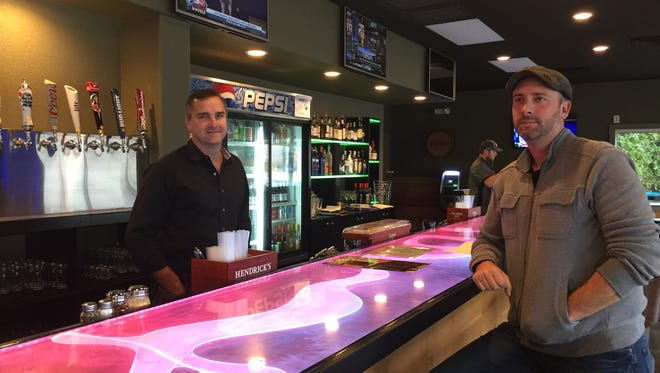 Todd Link (left) and Tyler Vogt at the bar of the new Rib Mountain Taphouse.