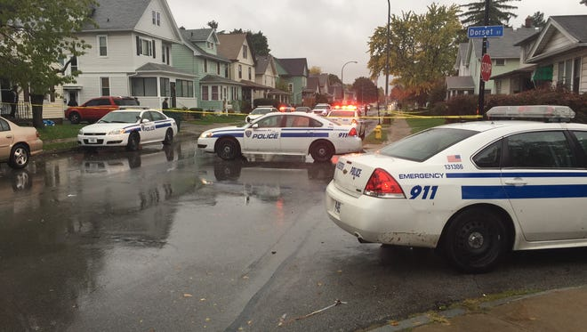 Rochester police on scene of a shooting on Bay Street Friday.