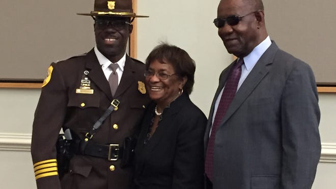 Lt. Col. Vaughn M. Bond takes a picture with his mother and father after a pinning ceremony at the John M. Clayton Hall at the University of Delaware in Newark on Friday, Oct. 21, 2016.