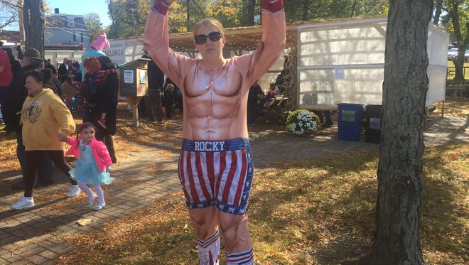 "Robyn Bentley of Fishkill dressed like Rocky Balboa from the ""Rocky"" films at the Hocus Pocus Parade in Beacon."