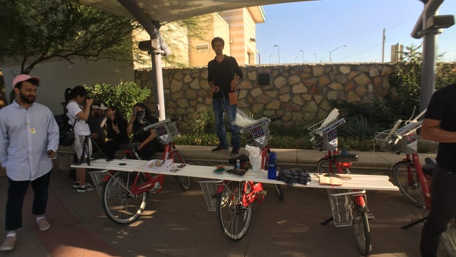 UTEP students and visiting artists from the Middle East create a temporary public art installation Friday at the Paso del Norte Bridge.