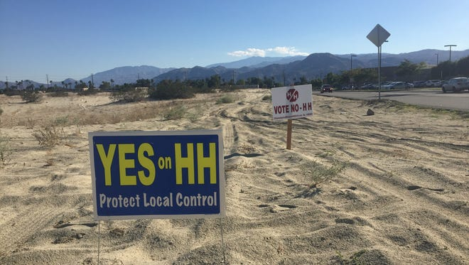 Signs posted at the corner of Dave Kelly Drive and Plumley Road in Cathedral City show support for and opposition to the proposed city charter.