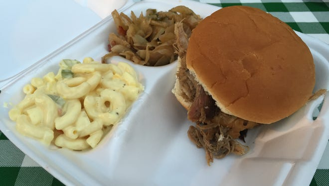 Sweet T's pulled pork sandwich, macaroni salad and smoked cabbage.