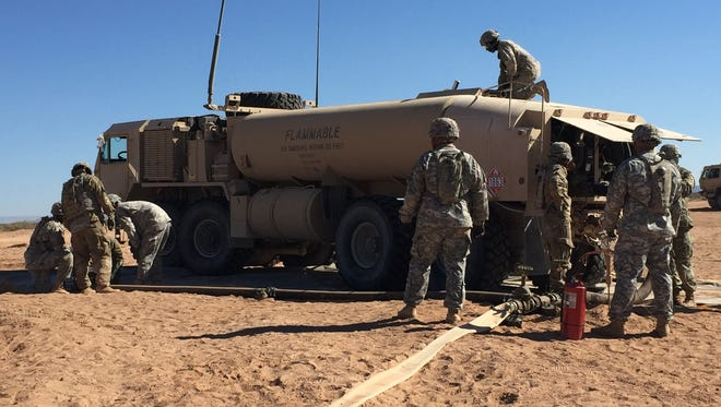Members of the 504th Composite Supply Company, 142nd Combat Sustainment Support Battalion operate a bulk refueling station and gas up a fuel tanker.