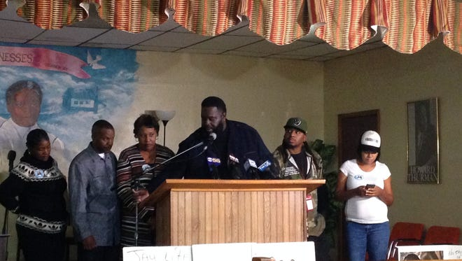 The family of Jay Anderson Jr., who was shot and killed by a Wauwatosa police officer, speaks during a news conference Wednesday. Michael Kemet, a family spokesman, is at the podium and Anderson's parents, Linda and Jay Sr., are to the left of him.