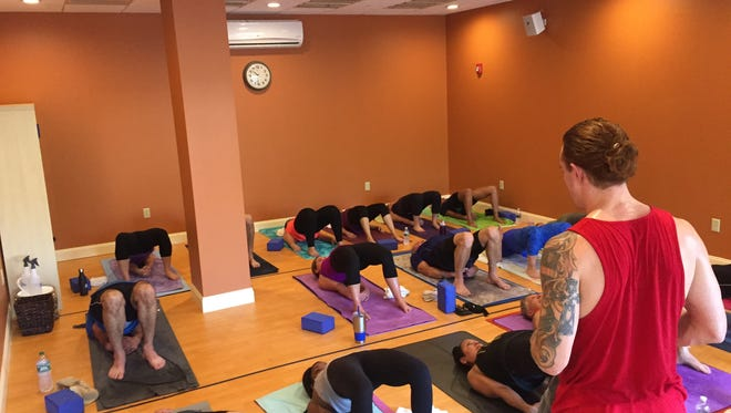 People do yoga at the Yoga Body Shop and Juice Lounge location in downtown Binghamton.