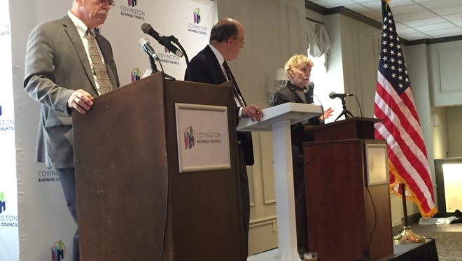Joe Meyer(left) and Mayor Sherry Carran(Right) square off in a debate earlier this month hosted by the Covington Business Council