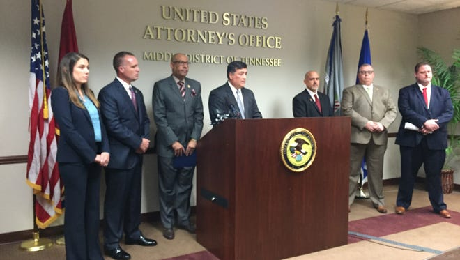 U.S. Attorney David Rivera, center, holds a press conference Oct. 27, 2016, to reveal the federal grand jury indictments of five people after two died and several overdosed in Murfreesboro last July.