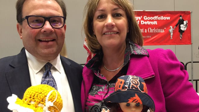 Dan and Amy Loepp, co-recipients of the 2016 Goodfellow of the Year award, hold two of the 10,000 dolls the charity plans to give to needy children in metro Detroit.
