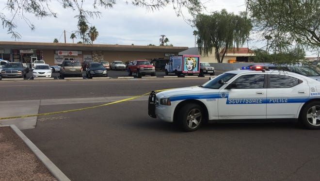 Scottsdale policeset up a perimeter near McDowell and Granite Reef roads after an armed suspect walked into a nearby bar. He was later arrested without incident.