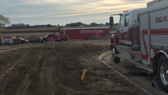 Emergency crews respond to a man who was trapped in a trench in Brandon on Friday morning.