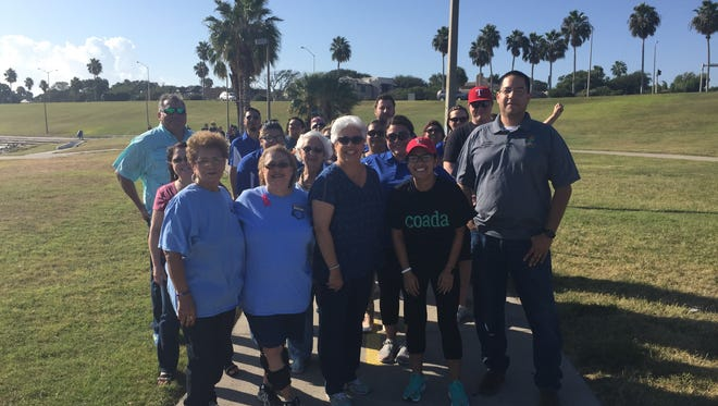 Several people joined Mayor Nelda Martinez at Cole Park on Friday for a 10-minute walk as part of the Texas Walks campaign.