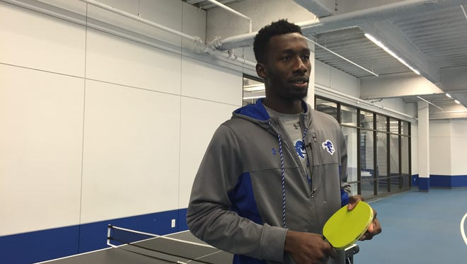 Michael Nzei discusses the finer points of ping pong at Seton Hall's Regan Fieldhouse.