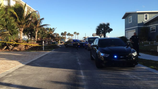Police investigate the circumstances surrounding the discovery of a body on the beach in Satellite Beach.
