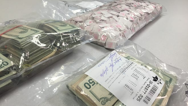 Anthony Borrelli / Press & Sun-Bulletin Police seized 2,700 bags of heroin with a street value of $40,000 and about $38,000 in cash during raids July 28 in Broome County. Police seized 2,700 bags of heroin with a street value of $40,000 and about $38,000 in cash during raids July 28 in Broome County.