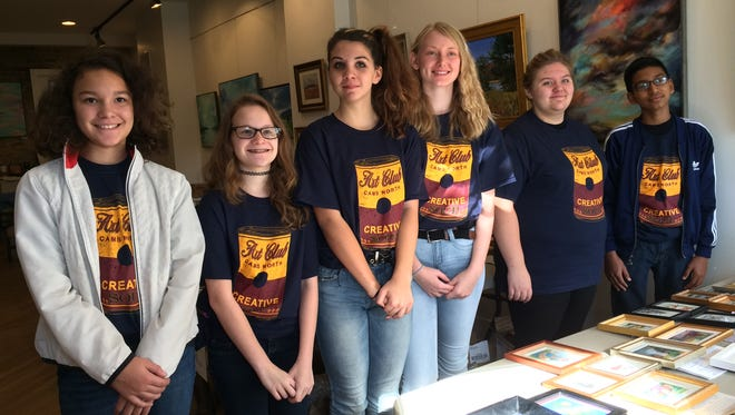 Chambersburg Area Middle School North Eighth Grade Art Club members assisted with preparation for the judging of Miniature Art 2016 on October 12. Left to right are Charly Vargas, Ashley Ruppe, Cassaundra Sleighter, MacKenzie Peters, Cheyenne Bailey and Edwin Leon.