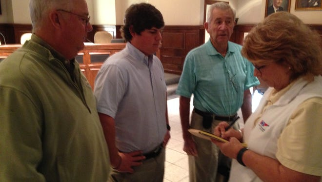 Marshall Talkington (center), owns Jackson Golf Management Inc., which will oversee Bent Tree Golf Course. He is pictured with his parents Tom R. (left) and Dana Talkington, and Sam Dawson, assistant to Jackson Mayor Jerry Gist at City Hall Tuesday.