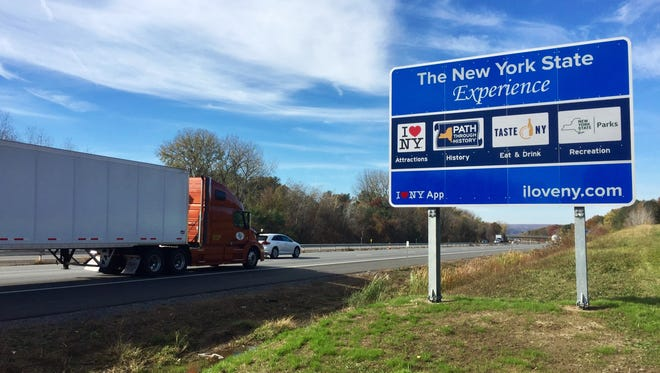 "A total of 514 signs -- including these ""motherboard"" signs -- have popped up in recent months across the state. This sign is on I-90 near Schenectady."