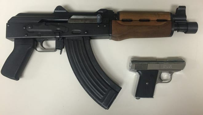 The AK-47-style pistol and handgun seized during the Vegas Lounge arrest. Photo provided by the Fort Myers Police Department.