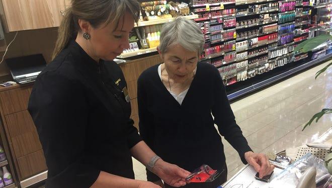 Emily Staryszak helps Martha Temple with selecting an eyelash curler.
