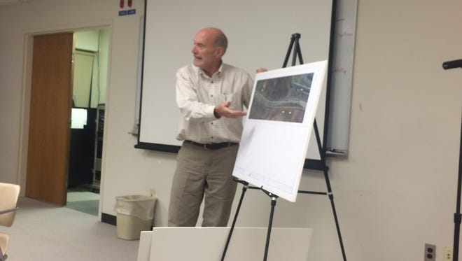 Mike Craine, managing director of the Livingston County Road Commission, explains the Challis Road improvement project to the Brighton City Council on Thursday.
