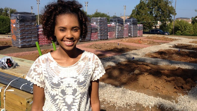 Andrea Pugh, a 2016 FAMU graduate, stands on the site of the future Eco-lab on campus.