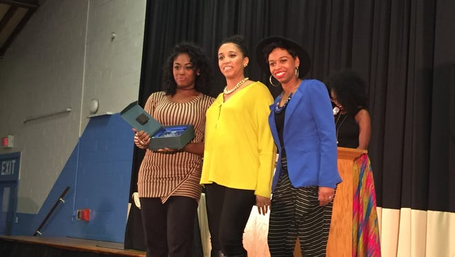 Three of the four Rossum sisters, from left, Corrinne, Ciara and Casey, accept the award for best singer during the first-ever Ray Crenshaw Neighborhood Awards at the Voni Grimes Gym in York. Not pictured is their fourth sister Carissa who could not attend. Several other local York residents won awards in honor of the legacy of service that Ray Crenshaw has given the city of York.