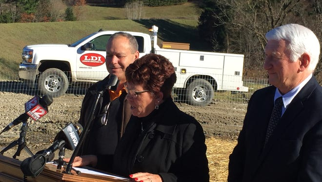 Debbie Preston is joined by Dan Schofield and Mike Sopchak as she announces the completion of an Airport Road reconstruction project