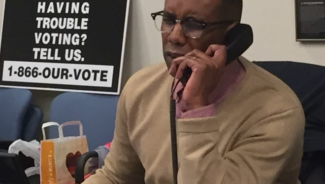 Terence Hastick answers calls last week from voters at the Election Protection Command Center in Washington, D.C.