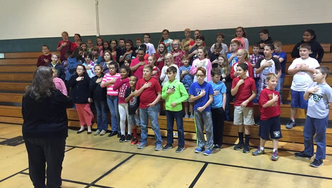 Tennessee Ridge and Erin Elementary School students pledge not to use drugs or tobacco during Red Ribbon Week in October.