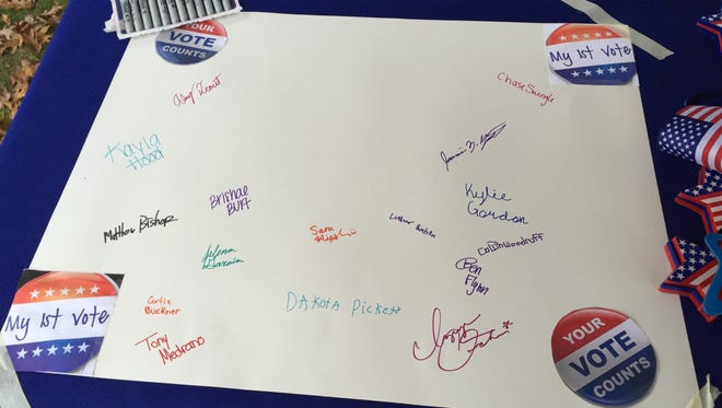 Jefferson High School students signed a poster after voting for the first time. The League of Women Voters of Greater Lafayette will give it to the high school to hang.