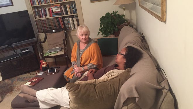Sharon Lucity, chats with her guest Coni Wiegert at her home.