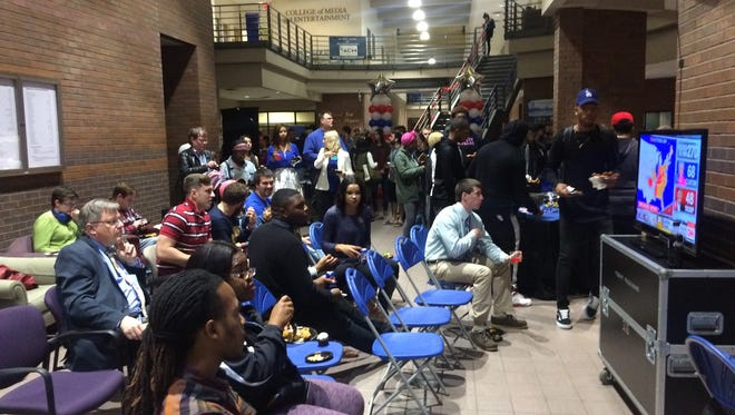 MTSU students watch the 2016 Election results pour in at the MTSU's Bragg Media and Entertainment Building Tuesday evening.