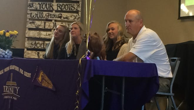 """Hannah Bratton signed her national letter of intent to play golf at Tennessee Tech on Wednesday with her family at Trinity Christian Academy. """"This has been my dream since I was in seventh grade, and it's amazing that it's become reality,"""" she said."""