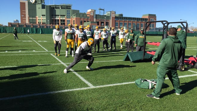 Running back James Starks moves through a ball security drill during practice.