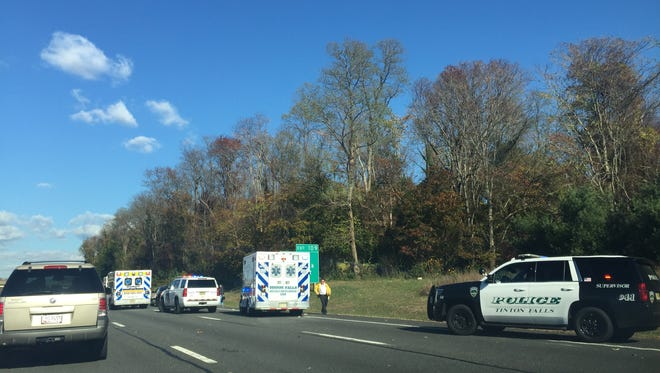 Police and medics respond to a motorcycle collision Friday morning on the Garden State Parkway.