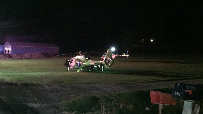 Three people were ejected from a single-vehicle wreck Friday night in the 800 block of National Road. Two of them died.